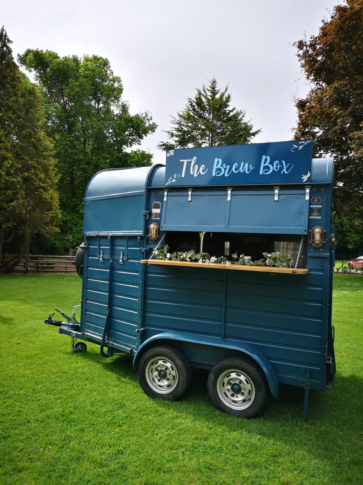 Brew Box on a Green, with bar folded down